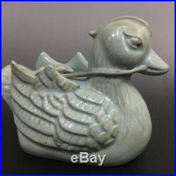 A pair of rare Chinese porcelain Ru kiln celeste glaze mandarin duck statues