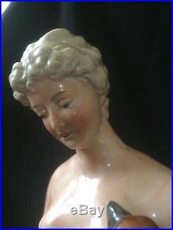Antique porcelain statue of women that feeds bird of prey